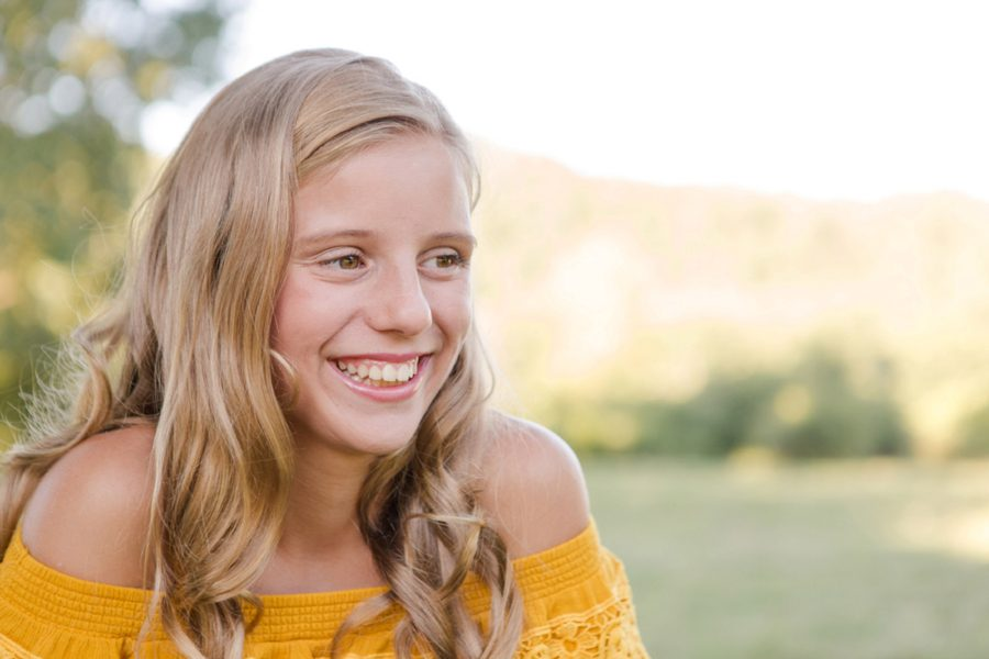Girl smiling during portrait session, Sweet 13 Photo Session in North Carolina