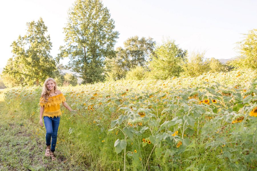 Child walking in sunflower field, Sweet 13 Photo Session in North Carolina