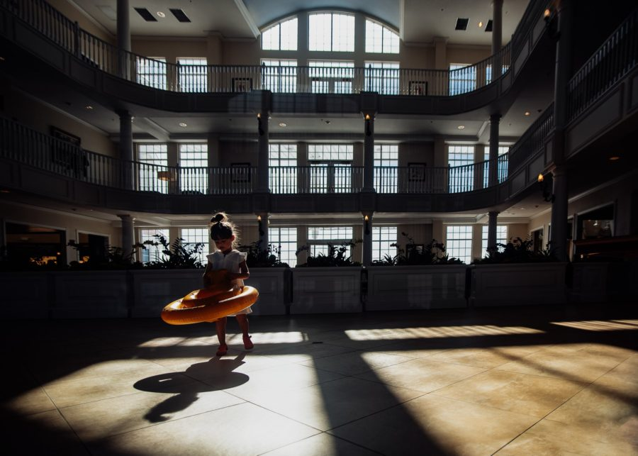girl standing in light in big hotel, child ready to go swimming, Daily Fan Favorite on Beyond the Wanderlust