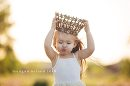 Girl putting crown on, little girl with windblown hair, Daily Fan favorite on Beyond the Wanderlust