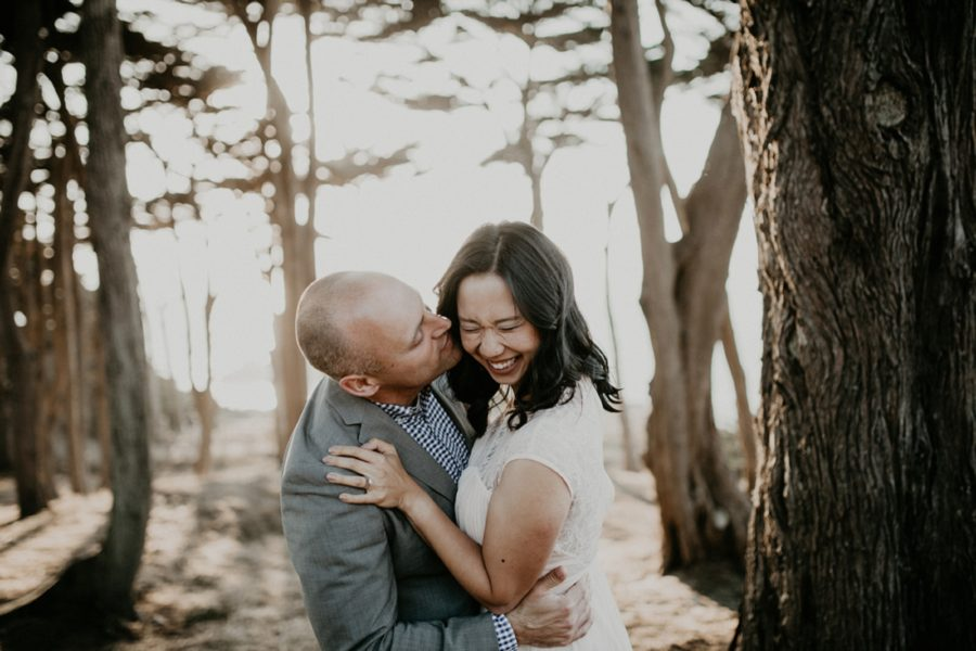 couple laughing during engagement photos, San Francisco Beach Engagement Photos