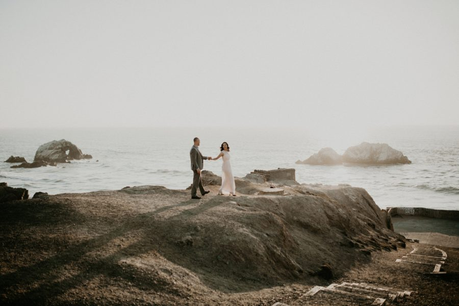 picture of couple by the ocean, woman and man walking, San Francisco Beach Engagement Photos