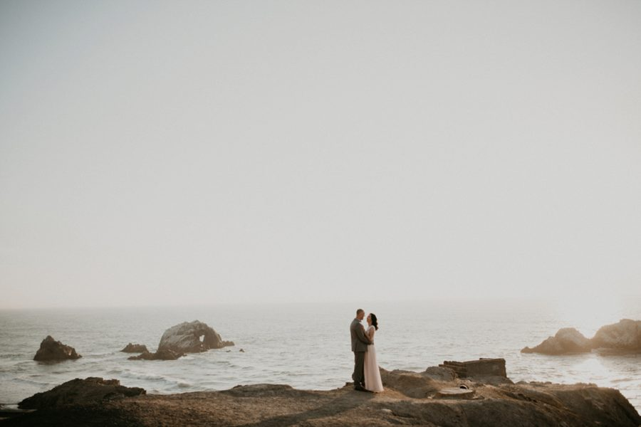 couple embracing by the ocean, San Francisco Beach Engagement Photos