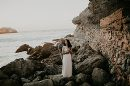 Couple posing on rocky shoreline, San Francisco Beach Engagement Photos