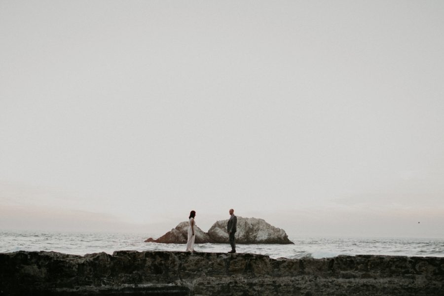 man and woman facing each other, San Francisco Beach Engagement Photos