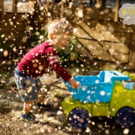 boy pushing dump truck, Walking Dot Photography Daily Fan Favorite
