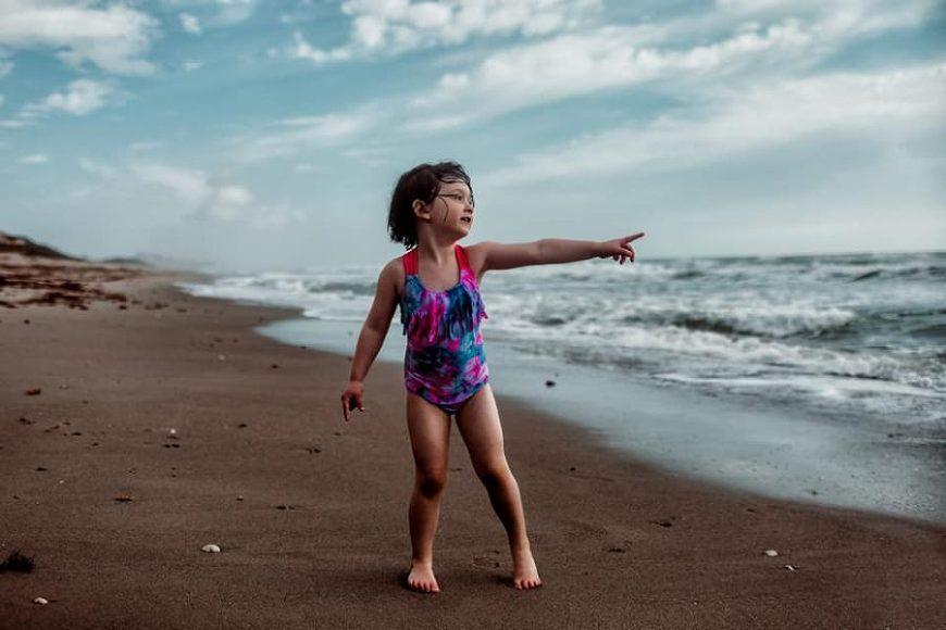 girl pointing towards ocean, Daily Fan Favorite