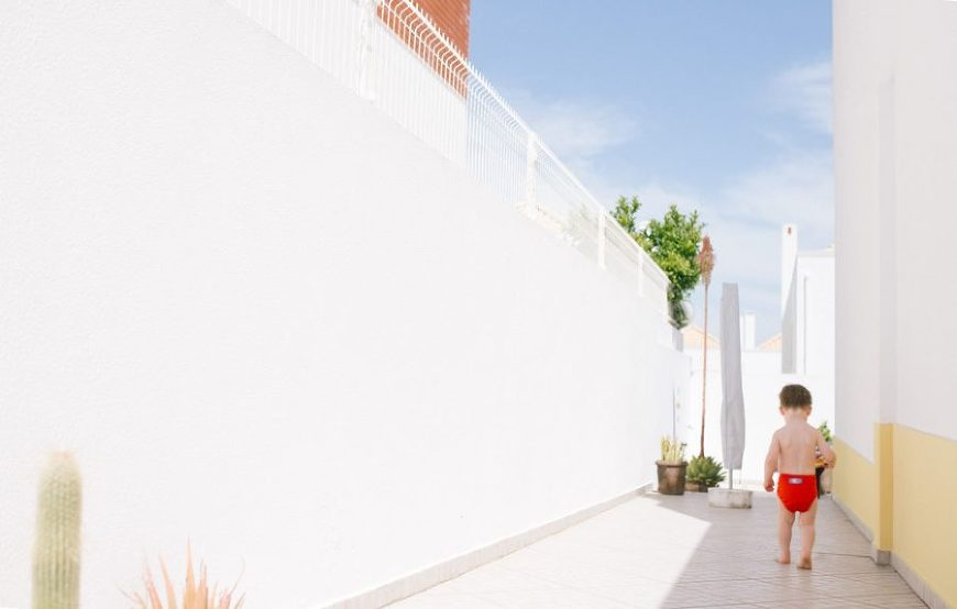 child walking in shadow of building, daily fan favorite