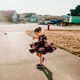 girl twirling in driveway, Sara Wroblewski Daily Fan Favorite