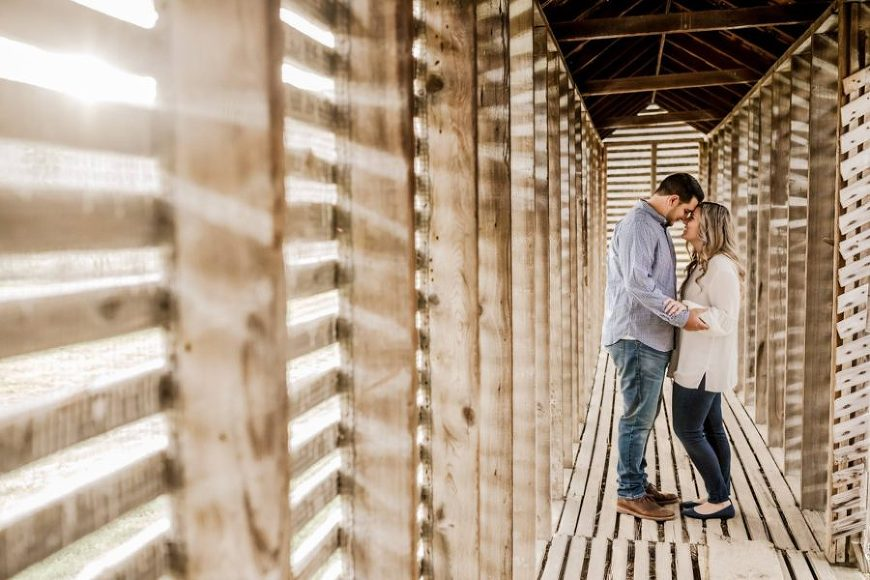 photo of man and woman touching foreheads, couple in corn crib, Daily Fan Favorite on Beyond the Wanderlust