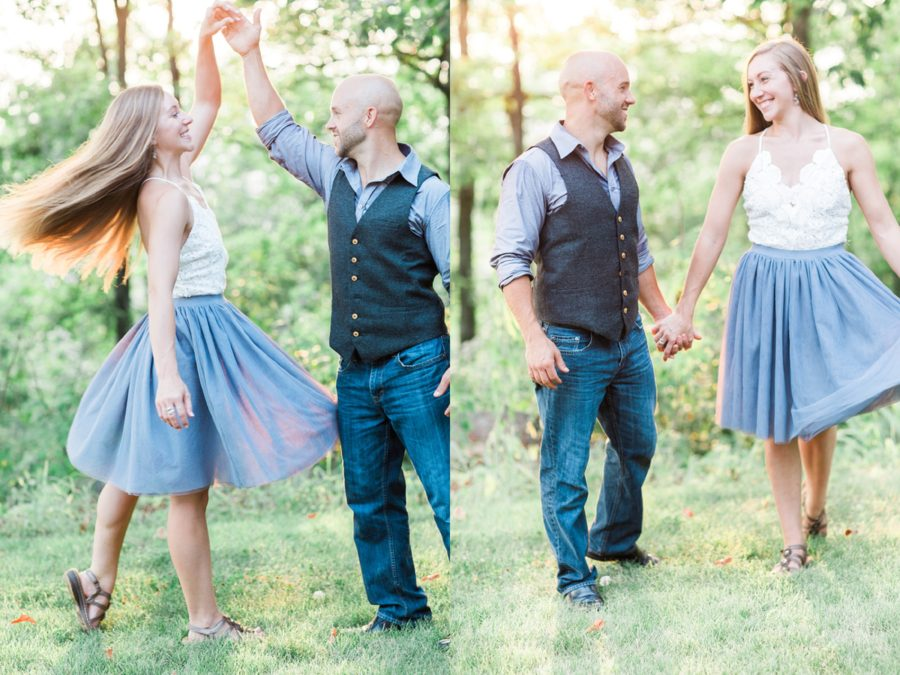 Couple dancing in grass, man twirling wife outside, Missouri Family Pictures with Flower Crowns
