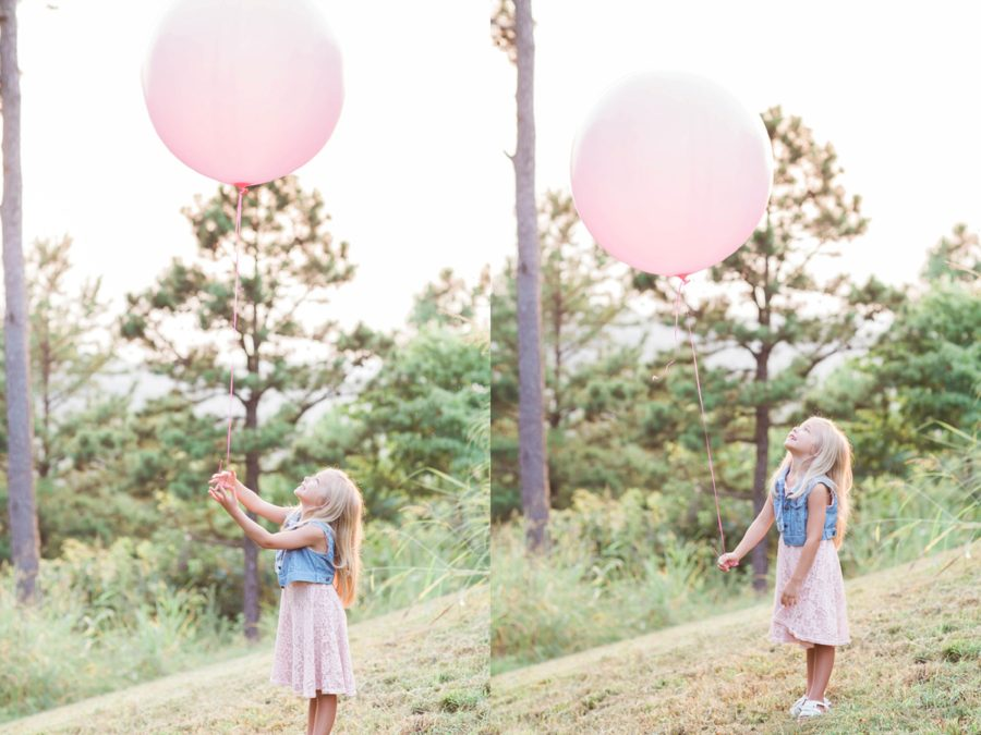 girl holding huge balloon, big round balloon, Missouri Family Pictures with Flower Crowns