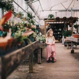 Girl in greenhouse, child surrounded by plants, Daily Fan Favorite on Beyond the Wanderlust by Jessica Standish Photography