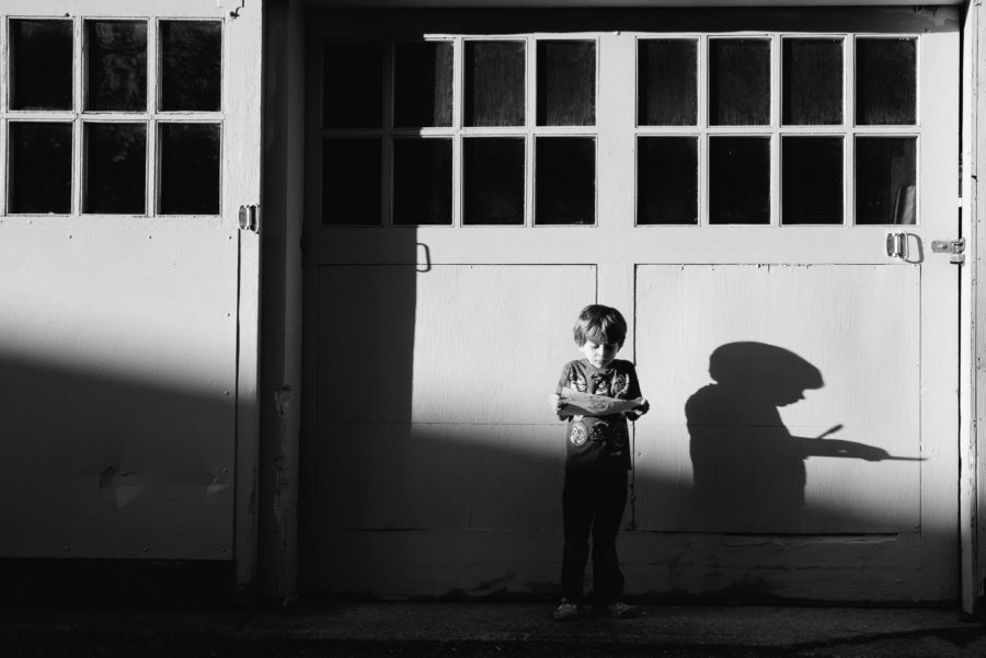 boy standing in front of garage door, shadow of boy, Daily Fan Favorite on Beyond the Wanderlust