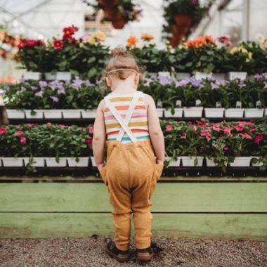 Child standing in front of flower display, Daily Fan Favorite by Andrea Martin Photography on Beyond the Wanderlust