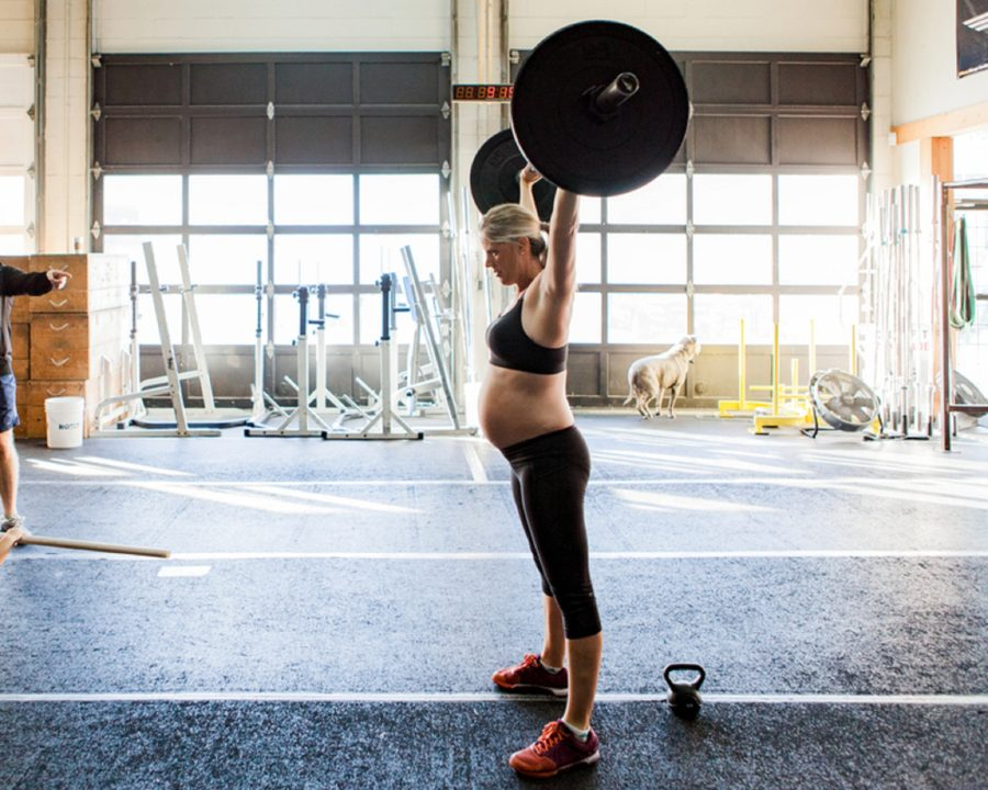 Pregnant woman lifting weights, mom lifting barbell, Documentary Maternity Pictures at Crossfit Gym