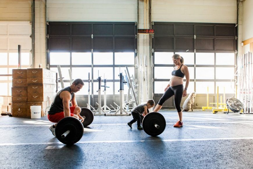 Man about to lift barbell, family at the gym, Documentary Maternity Pictures at Crossfit Gym