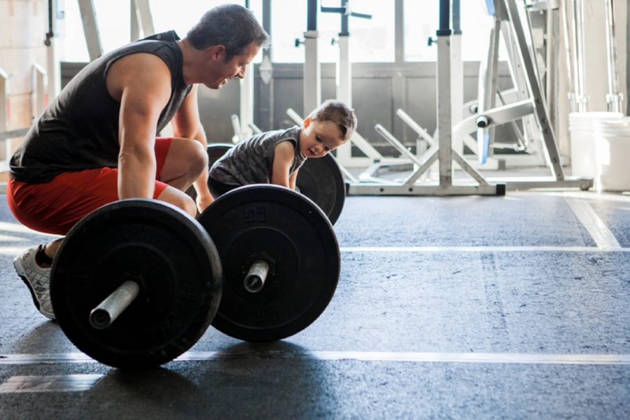 Father and son with barbells, Documentary Maternity Pictures at Crossfit Gym