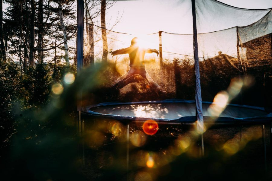 Child jumping on trampoline, jumping on trampoline with golden sun, Daily Fan Favorite on Beyond the Wanderlust