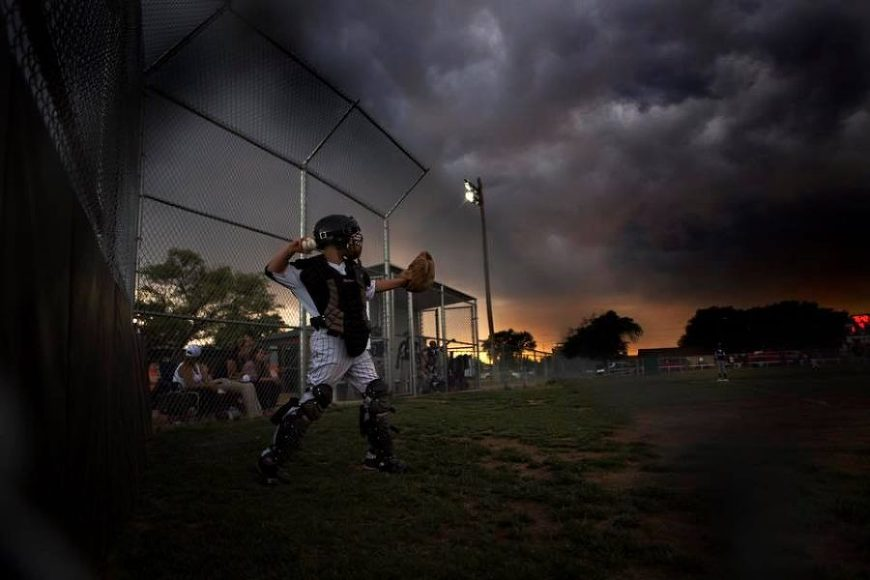 Stormy skies, boy throwing baseball, Beyond the Wanderlust Daily Fan Favorite
