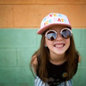 Girl smiling in front of color block wall, Daily Fan Favorite on Beyond the Wanderlust