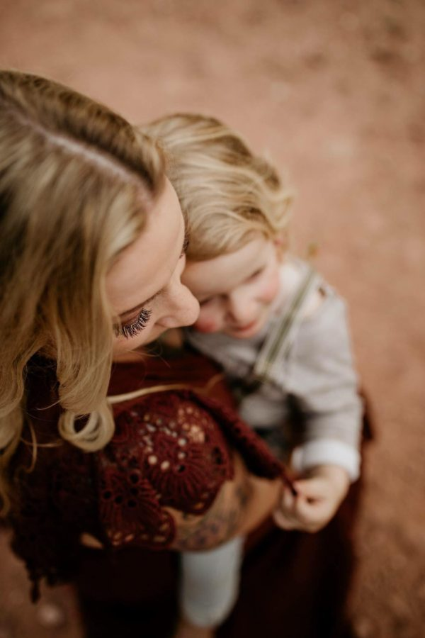 Overhead photo of mama holding child, picture with eyelashes in focus, Beyond the Wanderlust Daily Fan Favorite