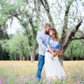 Couple standing in field with flowers, Engagment posing inspiration, Organic Engagement Pictures in Florida Wildflower Field