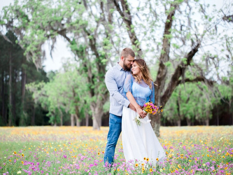 Couple snuggling in field, Engagment posing inspiration, Organic Engagement Pictures in Florida Wildflower Field