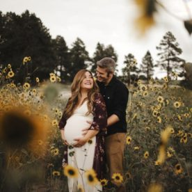 Couple posing in sunflower field, Outdoor Maternity Inspiration, Maternity picture ideas, Moody Sunflower Maternity Session in Colorado