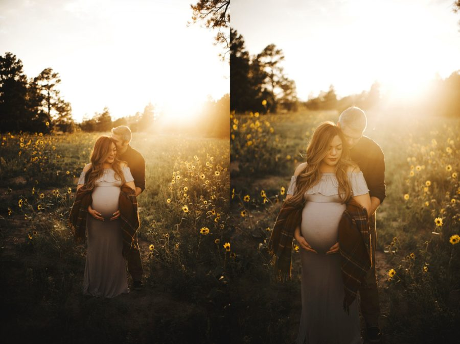 Sun filled maternity pictures, Couple snuggling together in sun drenched field, Moody Sunflower Maternity Session in Colorado