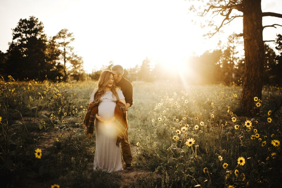 Backlit maternity picture, maternity pictures outside with sun, Moody Sunflower Maternity Session in Colorado