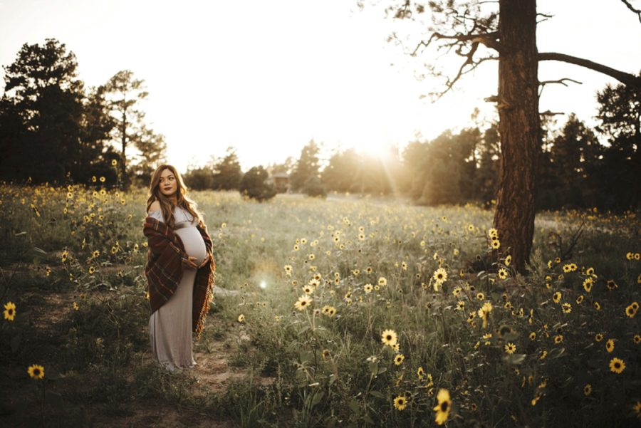 Maternity picture with shawl around woman, Moody Sunflower Maternity Session in Colorado
