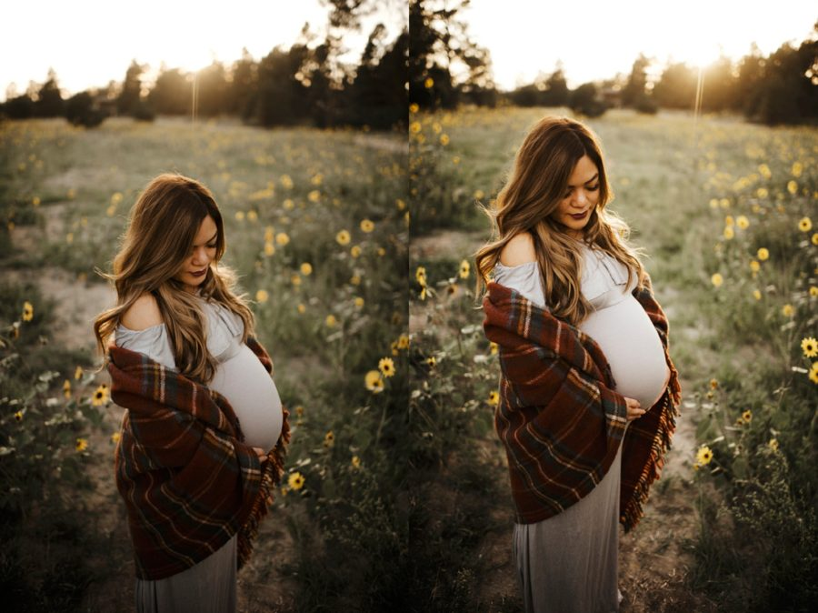 woman posing for maternity pictures outdoors, Moody Sunflower Maternity Session in Colorado
