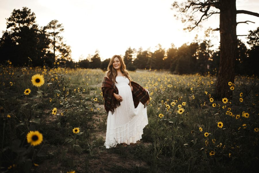 Picture of glowing pregnant woman, Moody Sunflower Maternity Session in Colorado