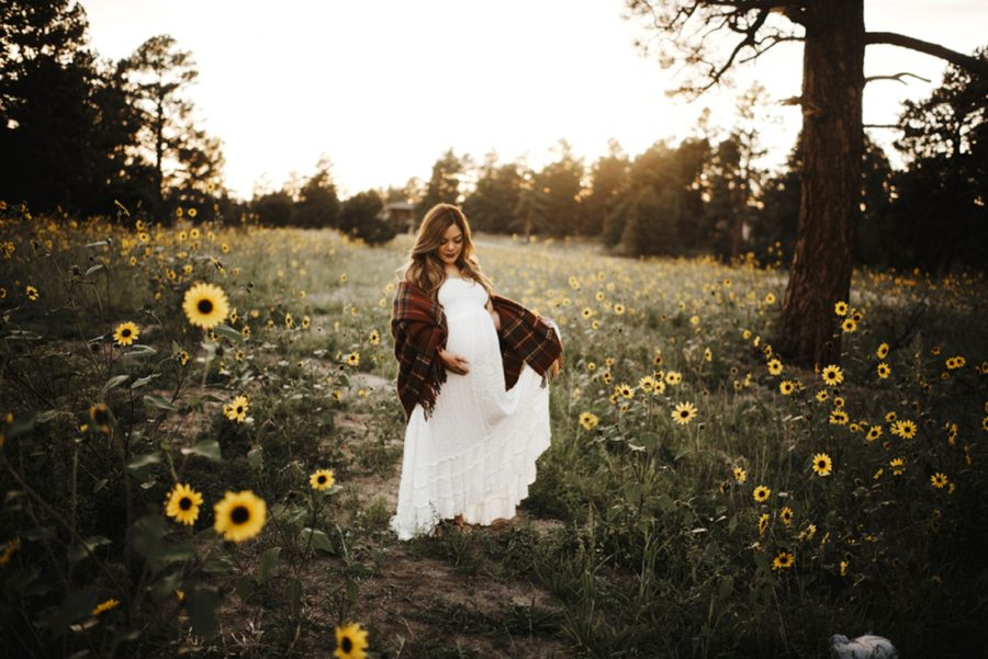 White maternity dress, woman wearing long flowy dress for maternity pictures, Moody Sunflower Maternity Session in Colorado