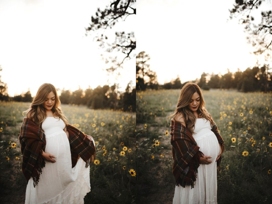Woman standing in sunflower field for maternity photos, Moody Sunflower Maternity Session in Colorado