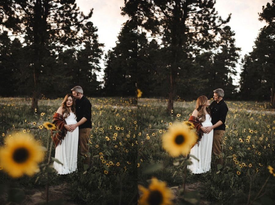 Sunflower maternity pictures, couple together in front of trees, Moody Sunflower Maternity Session in Colorado