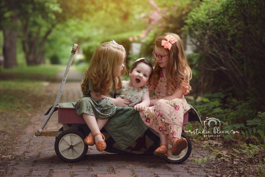 Sisters sitting in a wagon, Daily Fan Favorite on Beyond the Wanderlust