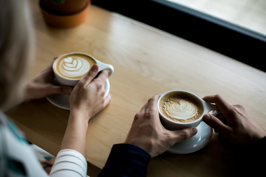 hands holding coffee cups, Springtime Engagement Photos in Downtown Olympia