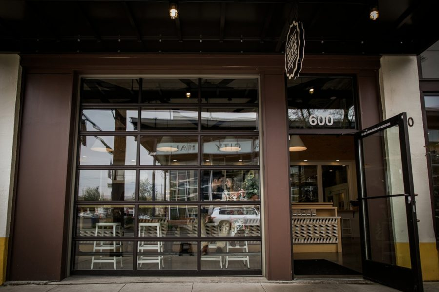 Couple sitting inside coffee shop, Springtime Engagement Photos in Downtown Olympia