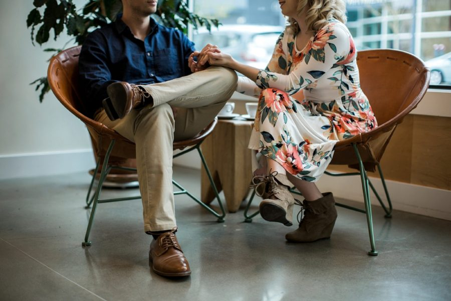 Couple enjoying each other in coffee chop, Springtime Engagement Photos in Downtown Olympia