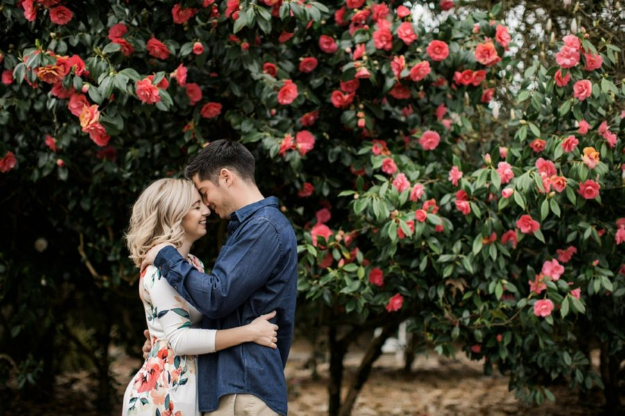 Man and woman with foreheads together, Springtime Engagement Photos in Downtown Olympia