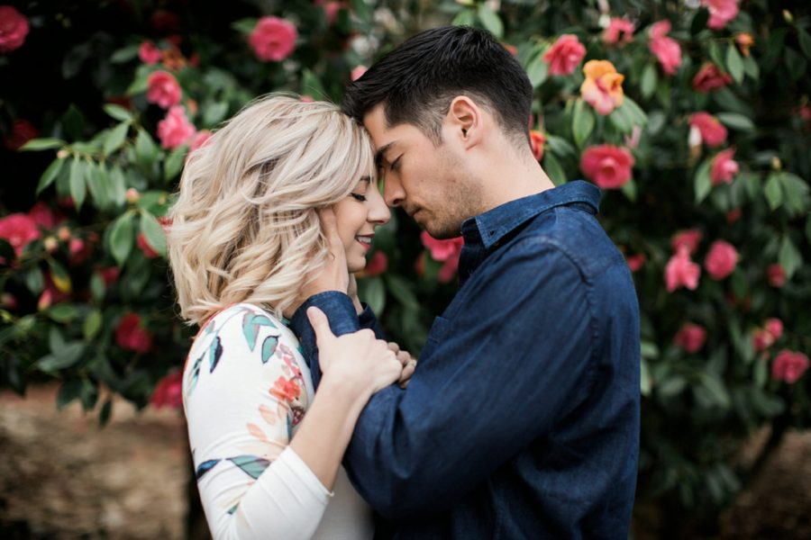 Couple outside with foreheads touching, Springtime Engagement Photos in Downtown Olympia
