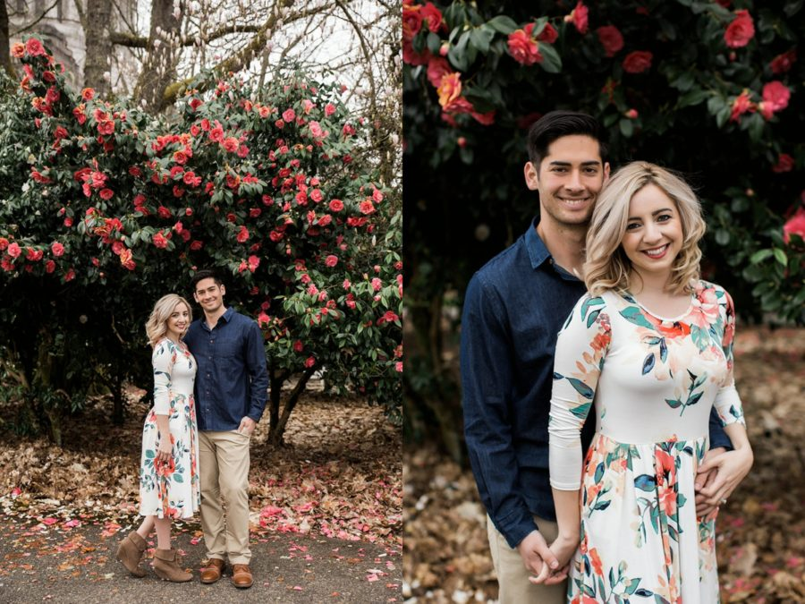 Couple smiling in front of pink flowers, Springtime Engagement Photos in Downtown Olympia