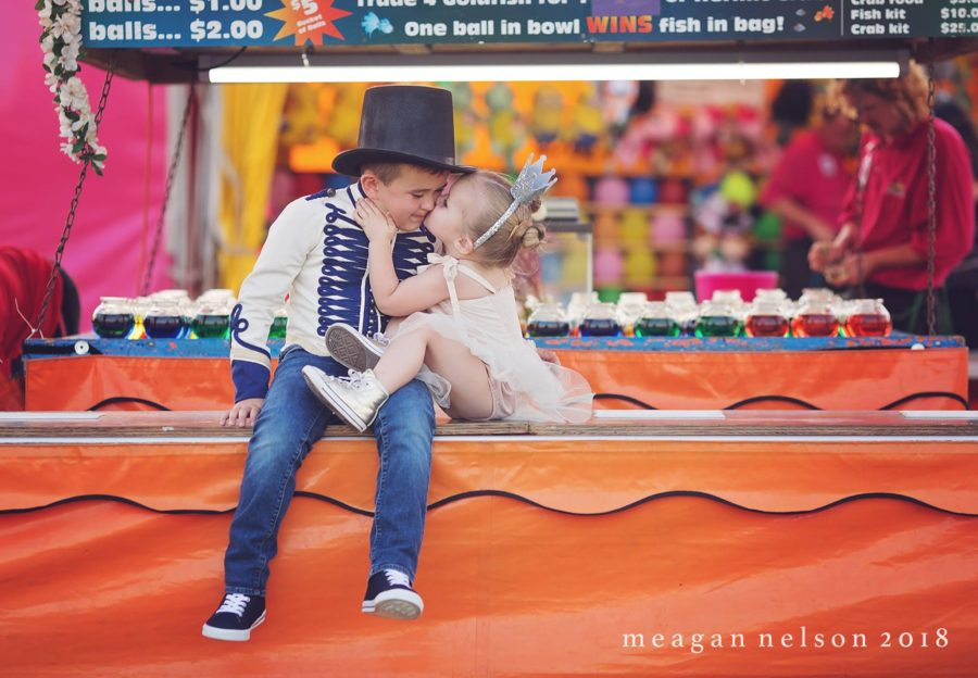 girl kissing boys cheek, circus themed portraits, Daily Fan Favorite on Beyond the Wanderlust