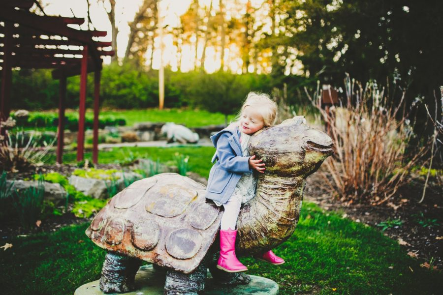 Girl on turtle statue, Daily Fan Favorite on Beyond the Wanderlust