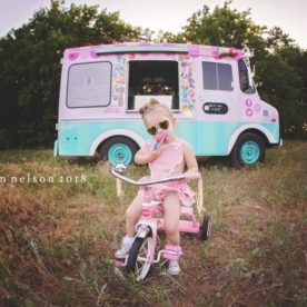 Girl eating popsicle in front of ice cream truck, Meagan Nelson Photography Daily Fan Favorite