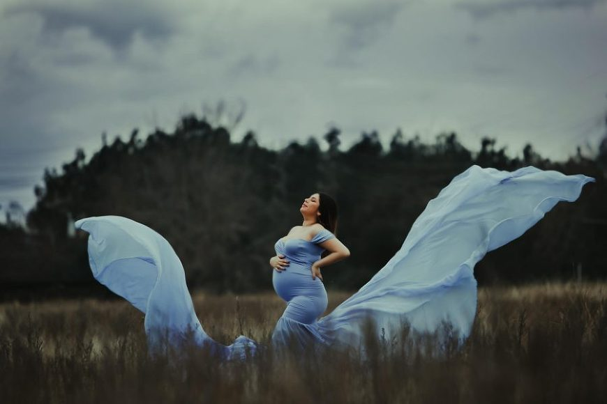 Maternity portrait with long dress in the air, Daily Fan Favorite