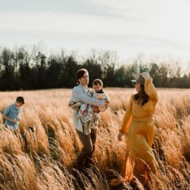 Family walking through field at sunset, Outdoor Golden Hour Session with Family of 3 Boys