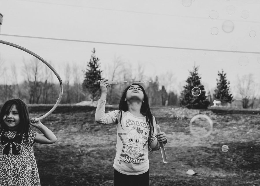 Girl blowing bubble and girl with hula hoop, Daily Fan Favorite on Beyond the Wanderlust